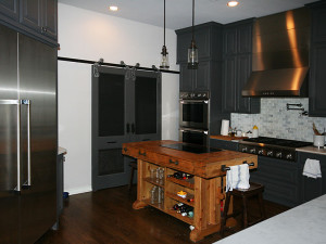 Rustic Kitchen With Barn Door Pantry